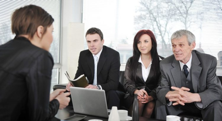 businesswoman-in-an-interview-with-three-business-people